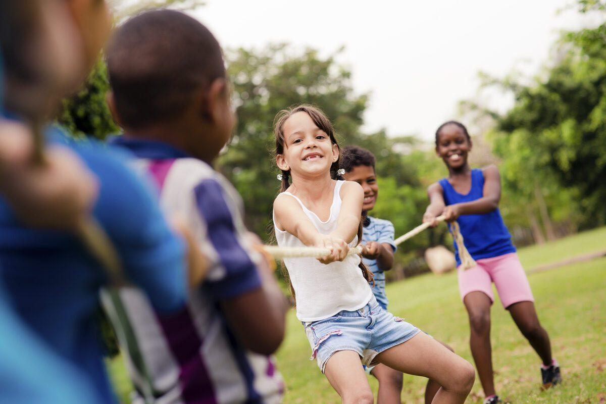 Children play tug of war at summer camp