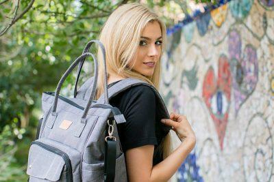 A woman models the Kalencom NOLA diaper bag backpack